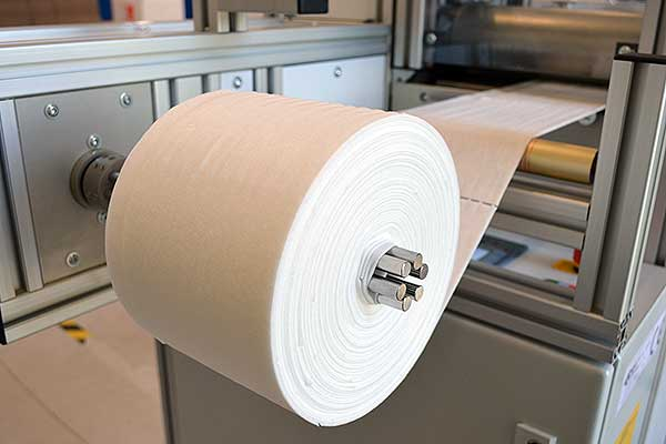 Production of nonwoven wipe rolls for surface disinfection